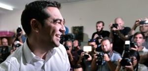 Leader of the Greek radical-left Syriza party and former Prime Minister Alexis Tsipras smiles after casting his vote at a polling station in central Athens on September 20, 2015. Greece's maverick leader Alexis Tsipras was ofighting for a second chance to govern the struggling eurozone nation in a tense election with rival conservatives that is proving too close to call. Over 9.8 million Greeks were registered to vote in an election that will select a new government to implement a three-year bailout adopted by the country's parliament last month.   AFP PHOTO/ LOUISA GOULIAMAKI